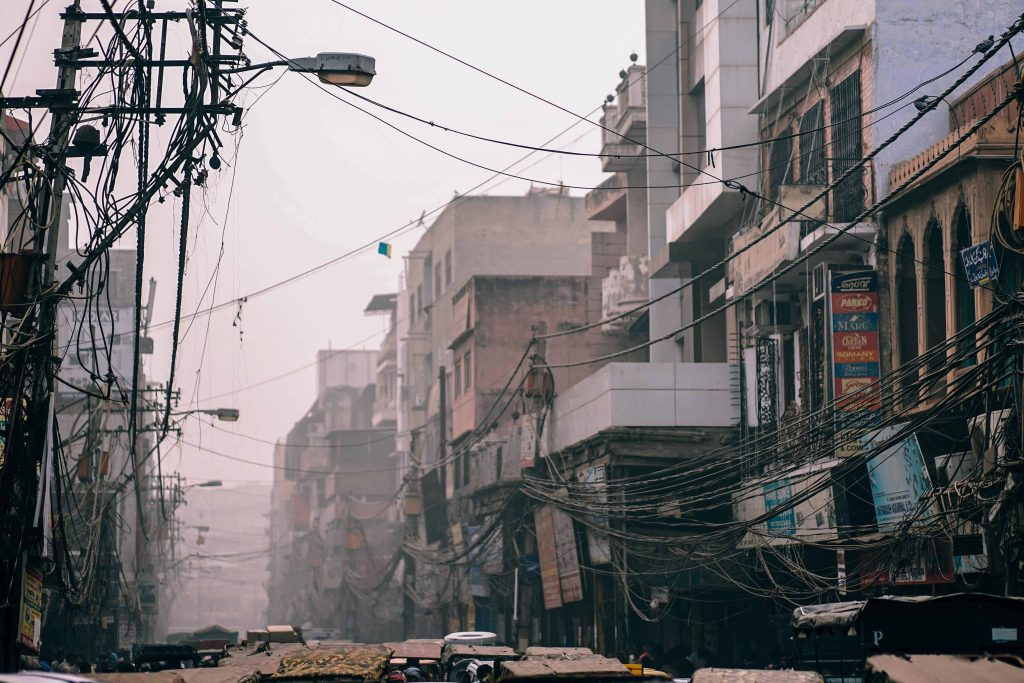 polluted air with fossil fuel particulate and buildings